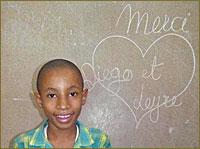 Donación para pizarras en escuelas de Haití y Familia sin Fronteras por la Infancia